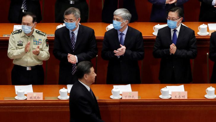Delegates applaud as Chinese President Xi Jinping arrives for the opening session of China's National People's Congress (NPC).