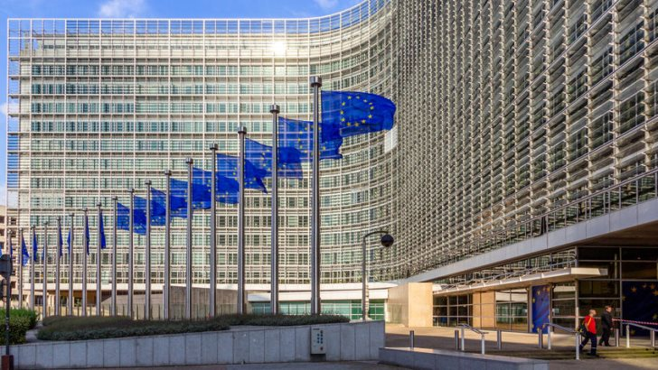 Row of EU Flags in front of the European Union Commission building in Brussels.