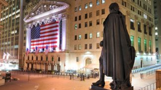 Behind the George Washington Statue looking towards the New York Stock Exchange on Wall Street