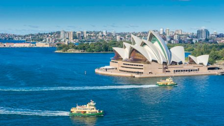 Aerial view of Sydney Harbour with ferries and cruises passing by Sydney Opera House