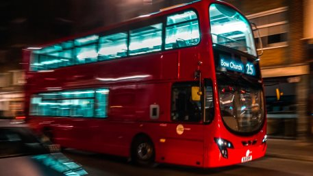 A red London bus in motion