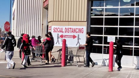 Ontario, Canada, November 11, 2020: People line up at a Costco Store wearing face masks during the Covid-19 virus pandemic