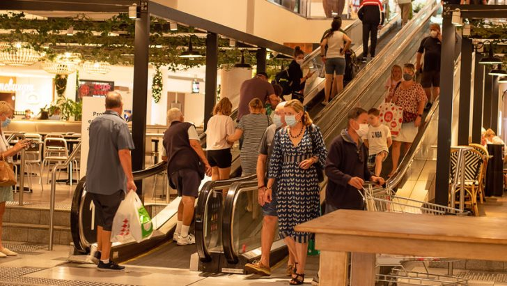 Sydney, Australia - 2020-01-04 Wearing face masks in public places are compulsory in Greater Sydney NSW. People wearing masks on the escalator at Westfield shopping centre