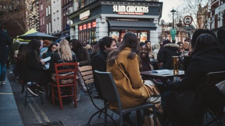 Soho, London | UK - 2021.04.16: People sitting in pubs and restaurants on Friday evening after ending of Coronavirus Lockdown