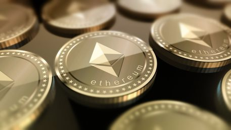 Glossy Ethereum in blurred closeup. Crypto-currency finance and banking as concept