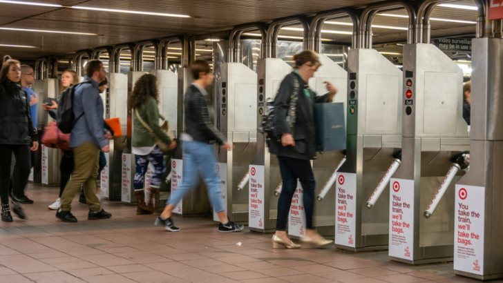 Commuters going through the turnstiles in a subway station in New York City