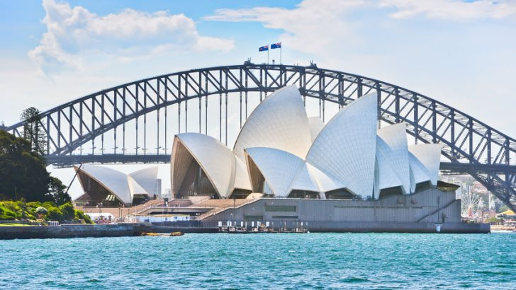"""Sydney Harbor Bridge and Opera House on a sunny day. AUDUSD Jumped as RBA Eyes Transition of the Economy to """"Expansion Phase"""""""