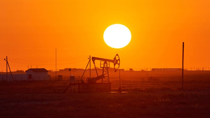 Pumpjack on sunset background. A pumpjack is the overground drive for a reciprocating piston pump in an oil well